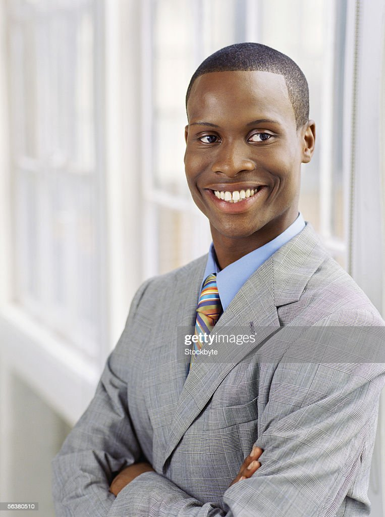 close-up of a businessman smiling : Stock Photo