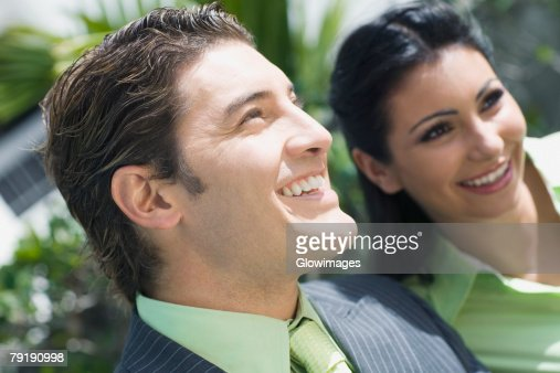 Close-up of a businessman smiling with a businesswoman : Stock Photo