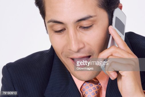 Close-up of a businessman talking on a mobile phone : Stock Photo