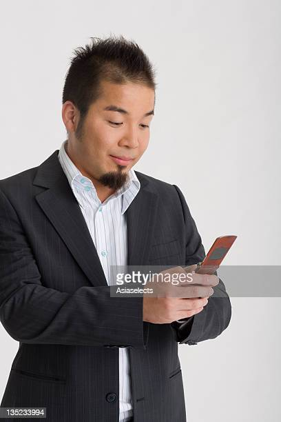 Close-up of a businessman using a mobile phone