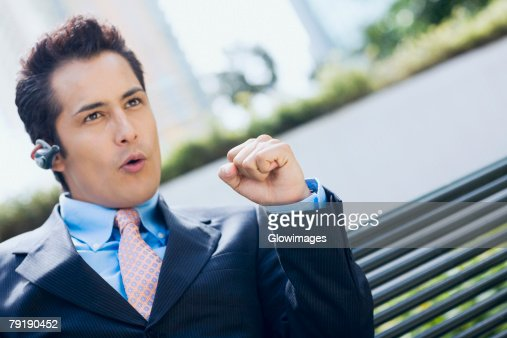 Close-up of a businessman wearing a bluetooth device and making a fist : Foto de stock