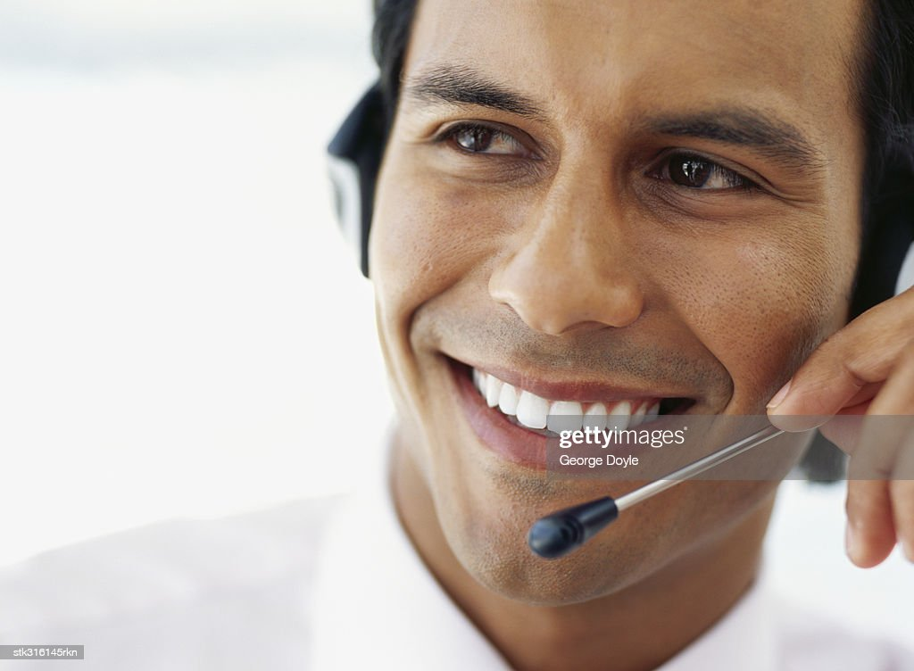 close-up of a businessman wearing a headset in an office : Stock Photo