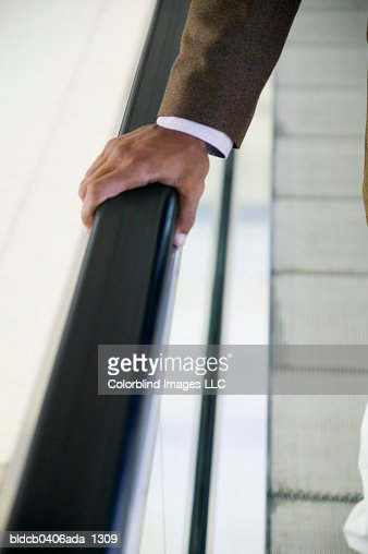 Close-up of a businessman's hand on a railing