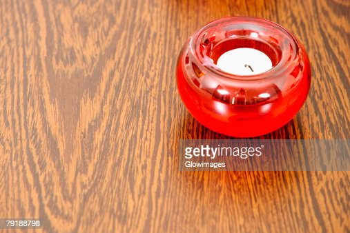 Close-up of a candle on a table : Stock Photo