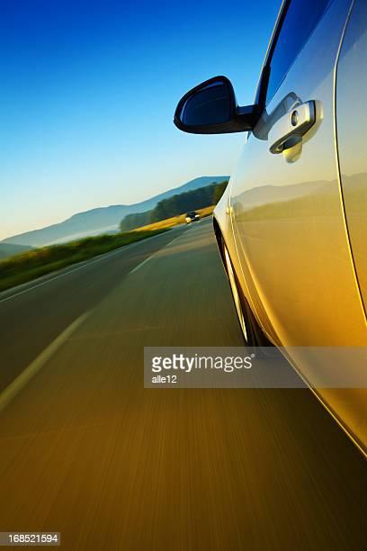 Closeup of a car driving on a road