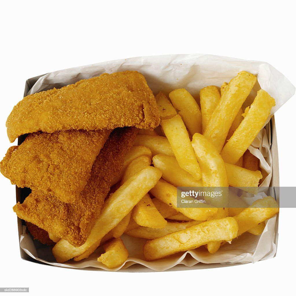 Close-up of a carton of french-fries and fish