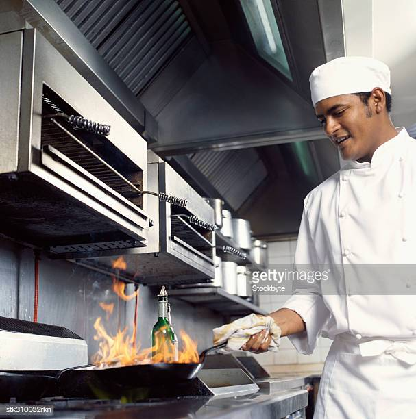 close-up of a chef cooking food in the kitchen