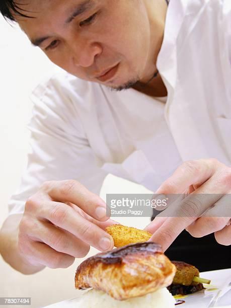 Close-up of a chef preparing food