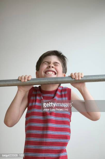 Close-up of a child doing chin-ups
