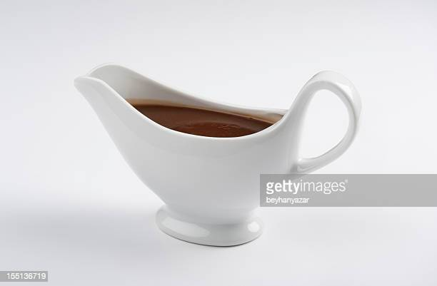 Close-up of a china gravy boat with a white background