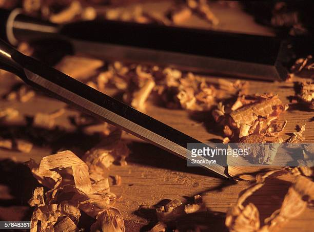 Close-up of a chisel and wood shavings