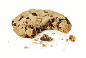 Close-up of a chocolate chip cookie with a bite