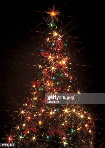 close-up of a Christmas tree lit up in the dark