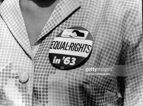 A closeup of a civil rights protest button being worn by a female demonstrator at the March on Washington Washington DC August 28 1963
