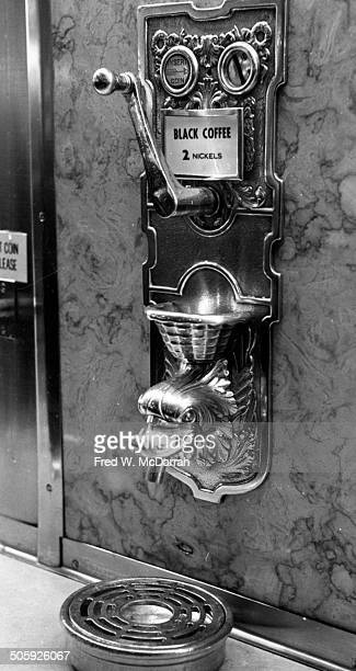 Closeup of a coffee machine at a Horn and Hardart automat cafeteria New York New York January 18 1964