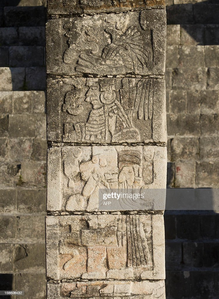 A close-up of a column at Chichen Itza archaeological park, in Yucatan state, Mexico on December 20, 2012. Mexico is one of five countries preparing to celebrate on December 21, the end of the Maya Long Count Calendar --Baktun 13-- which began in 3114 BC. AFP PHOTO/Pedro Pardo