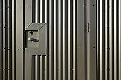 Close-up of a commercial building metal door.