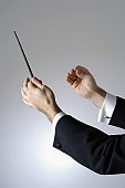 Close-up of a conductor holding a baton