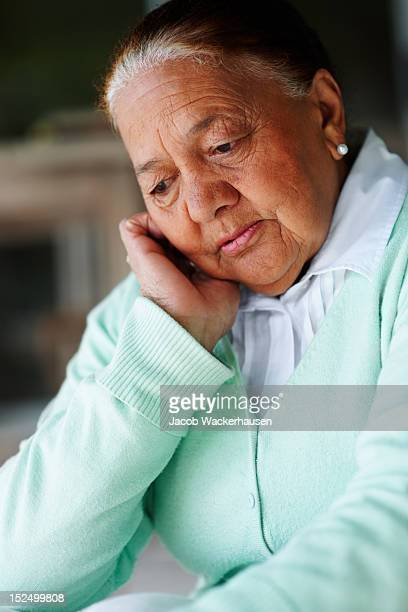 Close-up of a contemplative senior woman