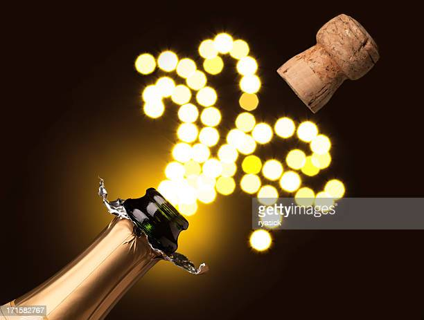 Closeup of a Cork Popping From A Bottle of Champagne