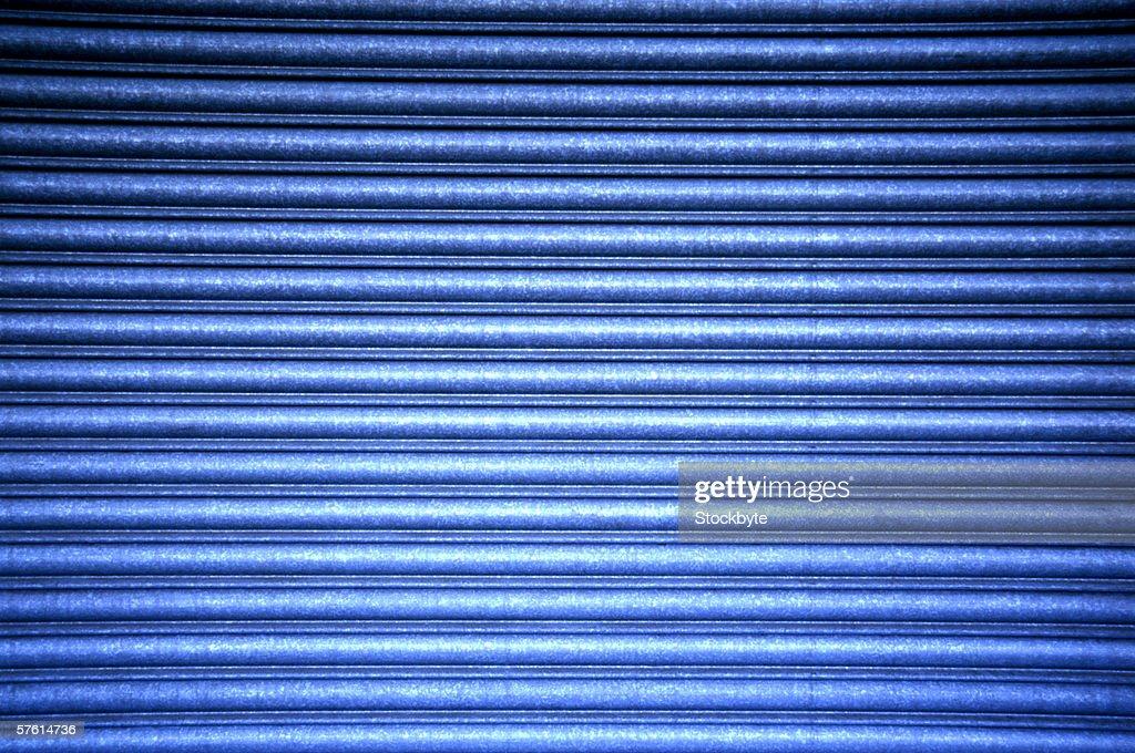 Close-up of a corrugated metal shutter