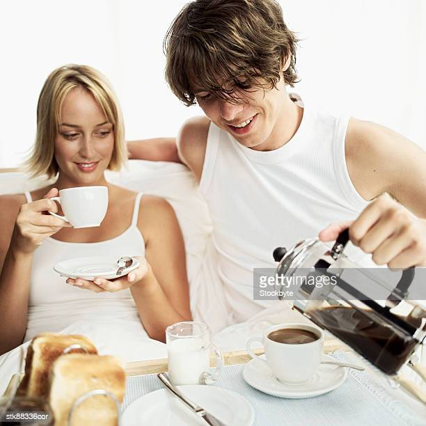 Close-up of a couple having breakfast in bed