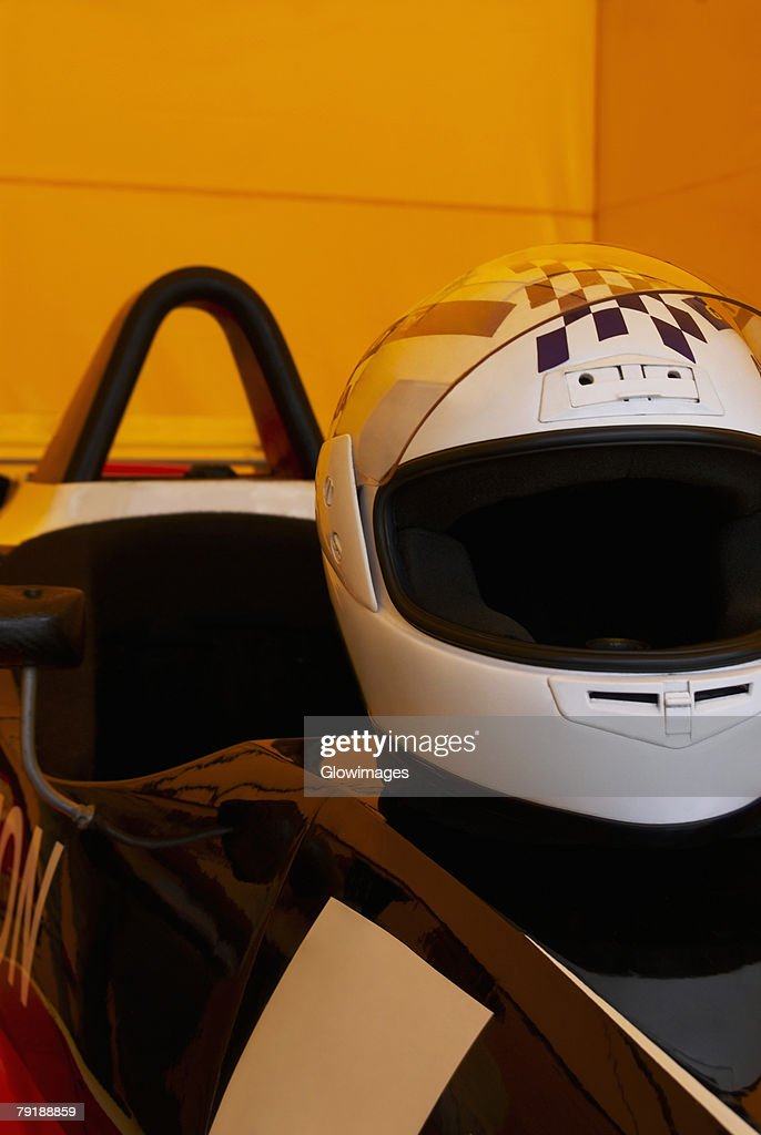 Close-up of a crash helmet on a racecar : Stock Photo