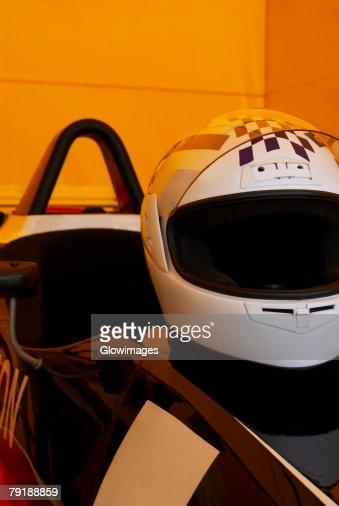 Close-up of a crash helmet on a racecar : Stock Photo