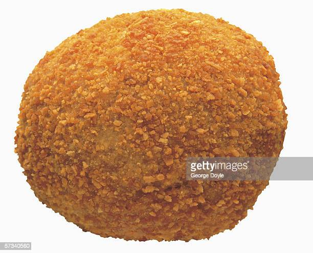 close-up of a crumb fried croquette