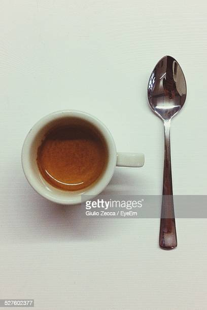 Close-Up Of A Cup Of Coffee With A Spoon