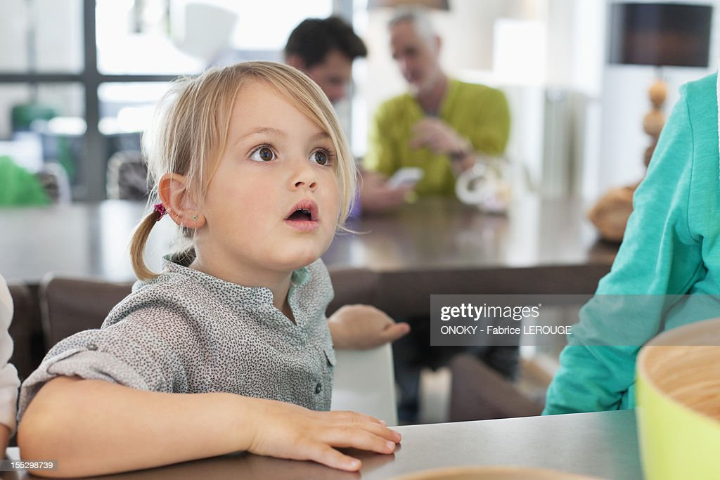 Close-up of a cute girl looking surprised : Stock Photo