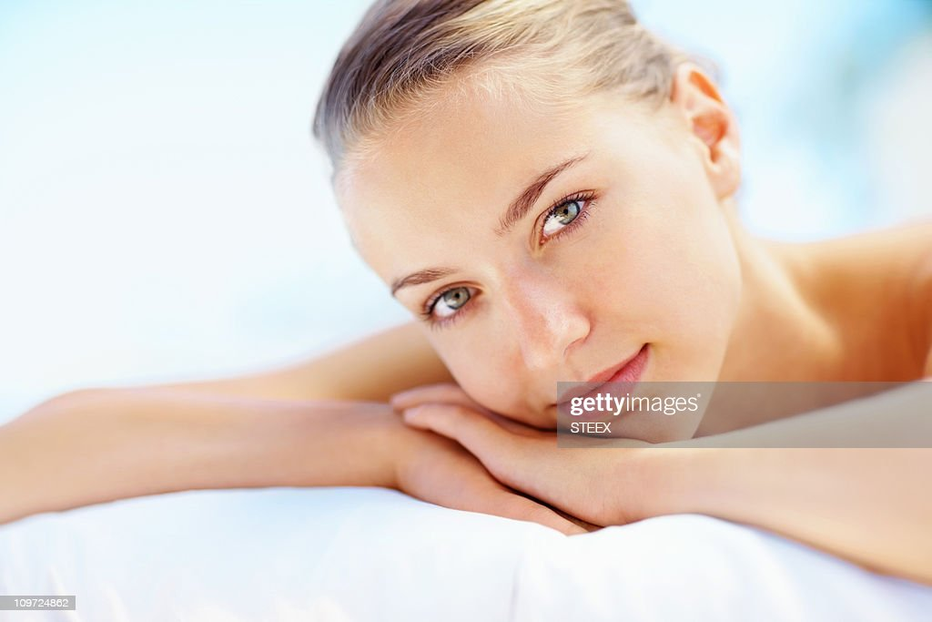 Closeup of a cute lady ready for spa treatment : Stock Photo