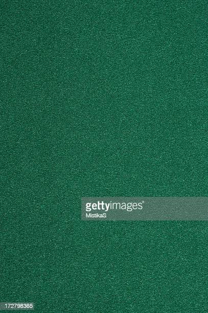Closeup of a dark green felt isolated