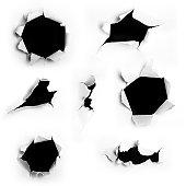 Closeup of a dark holes on white paper set