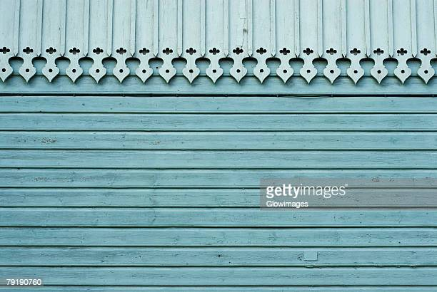 Close-up of a decorated roof on a wooden wall