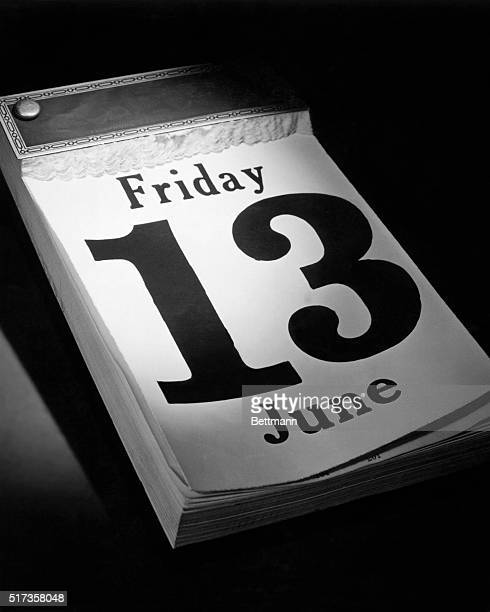 Closeup of a desk calendar with the date Friday June 13th exposed A dramatically lit object on a dark background Undated photograph