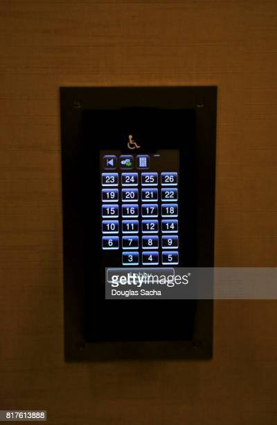 Close-up of a digital touch screen elevator control panel