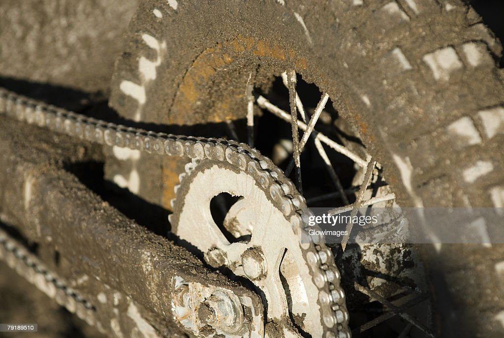 Close-up of a dirt covered motorcycle chain : Stock Photo