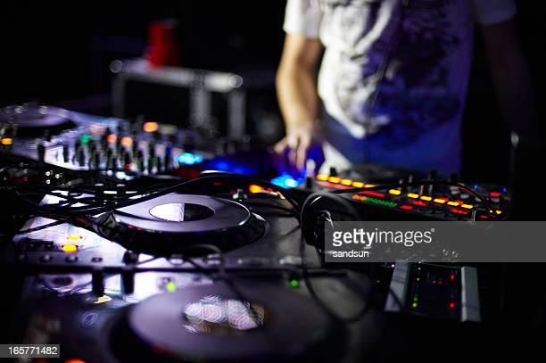 Closeup of a DJ's turntable and soundboard