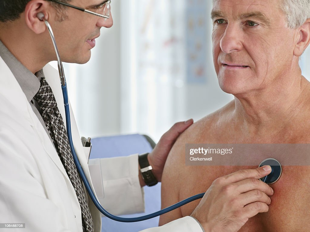 Close-up of a doctor examining senior man with stethoscope : Stock Photo
