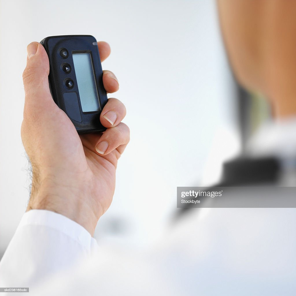 Close-up of a doctor holding pager