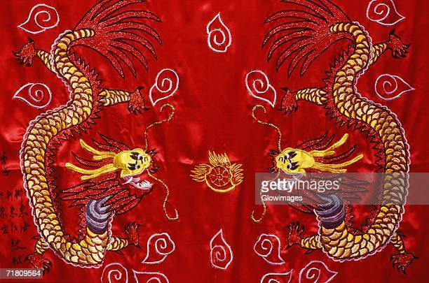 Close-up of a dragon on a curtain, China