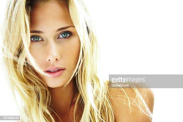 Closeup of a female blond on white background with copyspace