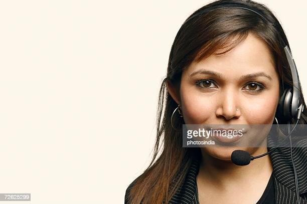 Close-up of a female customer service representative wearing a headset