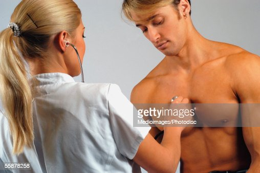 Doctor Woman Checkup Male Patient Stock Photo - Image of