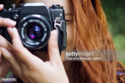 Close-up of a female photographer