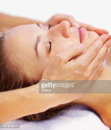 Close-up of a female receiving facial massage