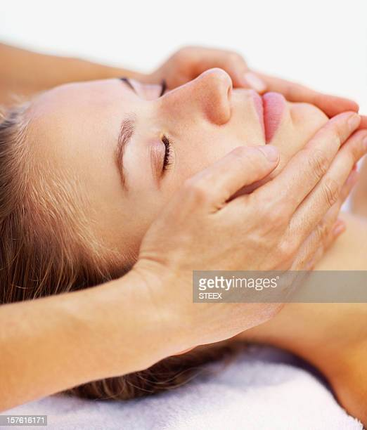 Close-up of a female receiving facial massage