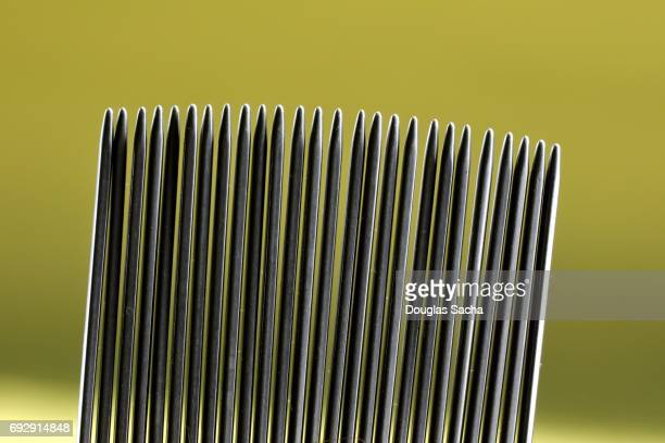 Close-up of a fine toothed head lice cleaning comb