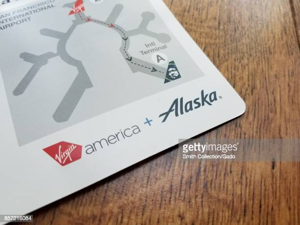 Closeup of a flyer providing details on combined flights operated by Virgin America and Alaska Airlines after the merger of the two companies on a...